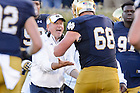 Sep 19, 2015; Irish head coach Brian Kelly celebrates with offensive lineman Mike McGlinchey (68) after a touchdown in the fourth quarter against Georgia Tech. Notre Dame won 30-22. (Photo by Matt Cashore)