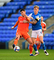 Blackpool's Gary Madine vies for possession with Peterborough United's Frankie Kent <br /> <br /> Photographer Chris Vaughan/CameraSport<br /> <br /> The EFL Sky Bet League One - Peterborough United v Blackpool - Saturday 21st November 2020 - London Road Stadium - Peterborough<br /> <br /> World Copyright © 2020 CameraSport. All rights reserved. 43 Linden Ave. Countesthorpe. Leicester. England. LE8 5PG - Tel: +44 (0) 116 277 4147 - admin@camerasport.com - www.camerasport.com