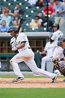Marcus Semien (6) of the Charlotte Knights follows through on his swing against the Pawtucket Red Sox at BB&T Ballpark on August 10, 2014 in Charlotte, North Carolina.  The Red Sox defeated the Knights  6-4.  (Brian Westerholt/Four Seam Images)