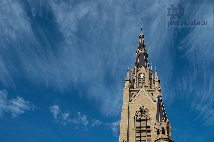 Oct. 22, 2014; Cirrus clouds form above the steeple on the Basilica of the Sacred Heart. (Photo by Barbara Johnston/University of Notre Dame)