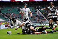 Christian Wade of England makes sure this time as he touches down to score his hat trick during the match between England and Barbarians at Twickenham Stadium on Sunday 31st May 2015 (Photo by Rob Munro)