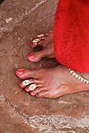 Indian women adorn themselves with jewellery, much of which has symbolic meaning. A married woman wears rings on her toes.