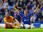 Rangers v Motherwell 16.9.01: Tore Andre Flo celebrates his goal with Martyn Corrigan dejected