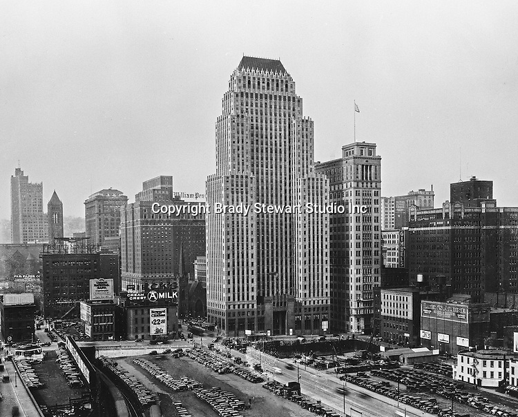 Pittsburgh PA: Constructed in 1929, this is a view of the Koppers Building with the new Gulf Building construction site in the foreground.  The new Grant Building is in the background (far left)
