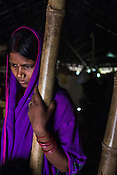 16 year old Lal Chuni Devi waits for Srikanthi Devi's (not in picture) to finish her lunch in their house in Ramgarwa village in Raxaul district in Bihar, India.