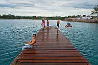 Boys swimming and fishing from dock in Cojimar,Havana, where Hemingway lived.