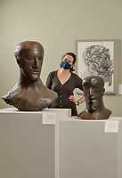 BNPS.co.uk (01202) 558833<br /> Pic: ZacharyCulpin/BNPS<br /> <br /> PICTURED: Also on display in the museum are these stunning Elisabeth Frink sculptures. Museum conservator, Riva Boutylkova with the sculptures<br /> <br /> An important Roman mosaic that has been saved for the nation went on display today at a county museum.<br /> <br /> The Dorset Museum unveiled the 1,700-year-old panel depicting a leopard attacking an antelope that it acquired earlier this year to stop it from going abroad.<br /> <br /> It forms the centrepiece for the venue which is about to reopen following a £16m transformation that has taken three years.