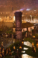 """27 JUL 2012 - LONDON, GBR - A chimney rises through the """"Green and Pleasant Land"""" set during the """"Pandemonium"""" section of the Opening Ceremony of the London 2012 Olympic Games in the Olympic Stadium in the Olympic Park, Stratford, London, Great Britain (PHOTO (C) 2012 NIGEL FARROW)"""