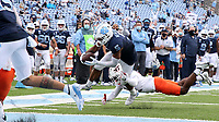 CHAPEL HILL, NC - OCTOBER 10: Dazz Newsome #5 of North Carolina is tripped by Nadir Thompson #12 of Virginia Tech as he dives into the end zone for a touchdown on a 6-yard run during a game between Virginia Tech and North Carolina at Kenan Memorial Stadium on October 10, 2020 in Chapel Hill, North Carolina.