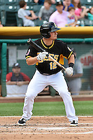 Tommy Field (12) of the Salt Lake Bees squares to bunt against the Reno Aces at Smith's Ballpark on July 23, 2014 in Salt Lake City, Utah.  (Stephen Smith/Four Seam Images)