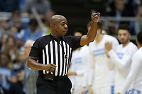 CHAPEL HILL, NC - FEBRUARY 1: Official Clarence Armstrong signals a foul during a game between Boston College and North Carolina at Dean E. Smith Center on February 1, 2020 in Chapel Hill, North Carolina.