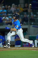 Luke Reynolds (34) of the Myrtle Beach Pelicans follows through on his swing against the Winston-Salem Dash at TicketReturn.com Field on May 16, 2019 in Myrtle Beach, South Carolina. The Dash defeated the Pelicans 6-0. (Brian Westerholt/Four Seam Images)