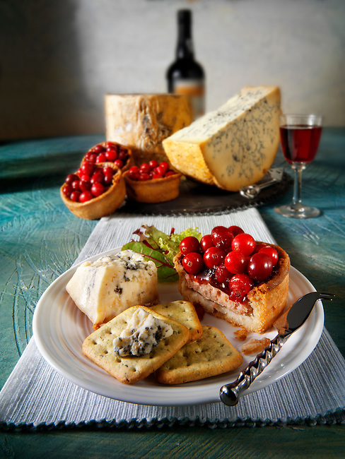 Traditional blue Stilton cheese  with cranberry pork pie stock photos