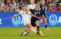 ORLANDO, FL - MARCH 05: Georgia Stanway #16 of England and Lindsey Horan #9 of the United States battle for a ball during a game between England and USWNT at Exploria Stadium on March 05, 2020 in Orlando, Florida.