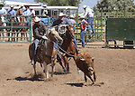 Travis Britton and Brent Tadman in double mugging action at the Minden Ranch Rodeo on Sunday, July 24, 2011, in Gardnerville, Nev. .Photo by Cathleen Allison