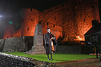 A bagpiper commemorates the 100 years since the end of the First World War on Remembrance Day at 6am outside Pembroke Castle, in Pembrokeshire, west Wales, UK. Sunday 11 November 2018