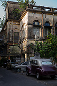 A classic car sits parked outside a Colonal house in Park Street Area in Kolkata, West Bengal  on Thursday, May 25, 2017. Photographer: Sanjit Das