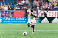 FOXBOROUGH, MA - JUNE 23: Dru Yearwood #16 of New York Red Bulls brings the ball forward during a game between New York Red Bulls and New England Revolution at Gillette Stadium on June 23, 2021 in Foxborough, Massachusetts.