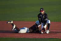 Western Kentucky Hilltoppers shortstop Kevin Lambert (24) blocks a low throw as Parker Johnson (18) of the Valparaiso Crusaders dives back into second base at Nick Denes Field on March 19, 2021 in Bowling Green, Kentucky. (Brian Westerholt/Four Seam Images)
