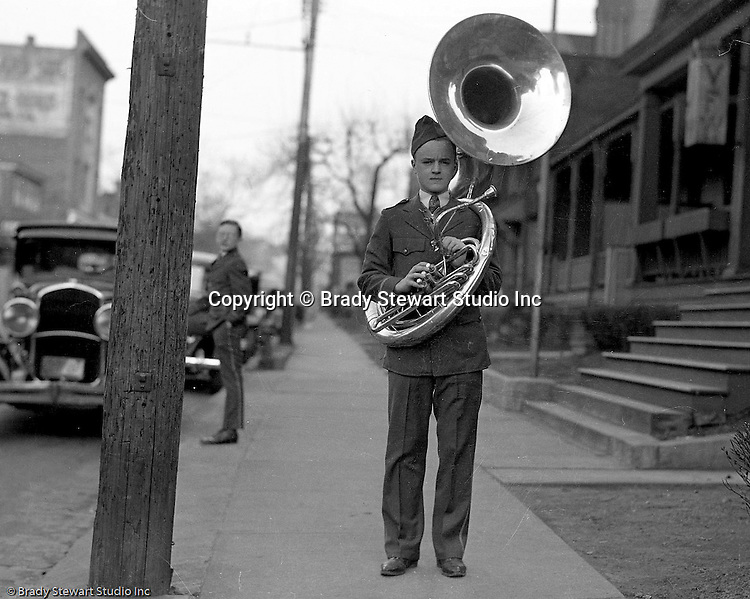 Wilkinsburg PA:  Brady Stewart Jr played the tuba in the Wilkinsburg High School Band.  View of him getting ready to go to a football in front of his house in Wilkinsburg.