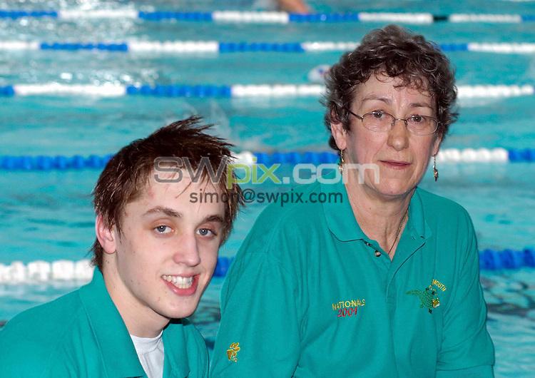 Pix: Chris Whiteoak/SWpix.com. Swimming, British Swimming World Championships 2005, Manchester. 17/03/2005...COPYRIGHT PICTURE>>SIMON WILKINSON>>01943 608782>>..Cockermouth Swimmer Craig Elliot and his coach Eleanor Walsh