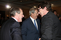 September 26 2012 - Montreal Quebec CANADA - Louis Audet, President & CEO of COGECO et Cogeco Cable,discuss with Pierre-Karl Peladeau, CEO QUEBECOR after speaking at the Canadian Club of Montreal's podium.<br /> <br /> <br /> PHOTO :  Agence quebec Presse -  Pierre Roussel