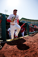 Tyler Henley (12) of the Springfield Cardinals runs onto the field prior to a game against the Frisco RoughRiders on April 16, 2011 at Hammons Field in Springfield, Missouri.  Photo By David Welker/Four Seam Images