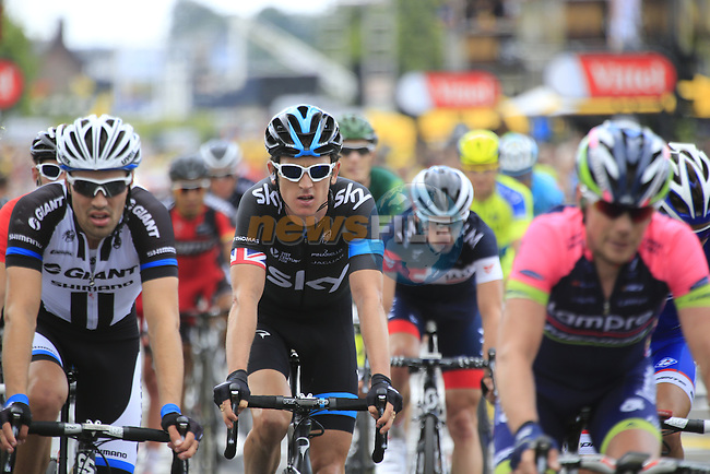 Riders including Geraint Thomas (WAL) Team Sky cross the finish line at the end of Stage 2 of the 2014 Tour de France running 200km from York to Sheffield. 6th July 2014.<br /> Picture: Eoin Clarke www.newsfile.ie