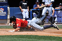 Staten Island Yankees catcher Nick McCoy #12 tags out State College Spikes runner Wes Freeman #45 during a game at Richmond County Bank Ballpark at St. George on July 14, 2011 in Staten Island, NY.  Staten Island defeated State College 6-4.  Tomasso DeRosa/Four Seam Images