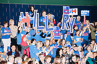 """Campaign volunteers hold up large letters spelling """"Hillary"""" as former Secretary of State and Democratic presidential candidate Hillary Rodham Clinton speaks at a rally at Nashua Community College in Nashua, New Hampshire, on Tues. Feb. 2, 2016. Former president Bill Clinton also spoke at the event. The day before, Hillary Clinton won the Iowa caucus by a small margin over Bernie Sanders."""