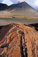 Pink sand on an ash plain in front of Mount Yasur, an active volcano on the island of Tanna, Vanuatu.