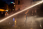 ISTANBUL, TURKEY: Police fire water cannon at protesters to disperse them from the area around Taksim square which has been the focus of recent anti-government protests.<br /> <br /> Protests that began nearly three weeks ago to try and protect an Istanbul park from redevelopment have spread across Turkey and become an expression of wider discontent with the government of Prime Minister Recep Tayyip Erdogan.<br /> <br /> Photo by Kamaran Najm/Metrography