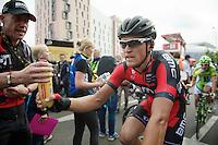 Greg Van Avermaet (BEL/BMC) handed a drink after crossing the finish line<br /> <br /> 2014 Tour de France<br /> stage 4: Le Touquet-Paris-Plage/Lille Métropole (163km)