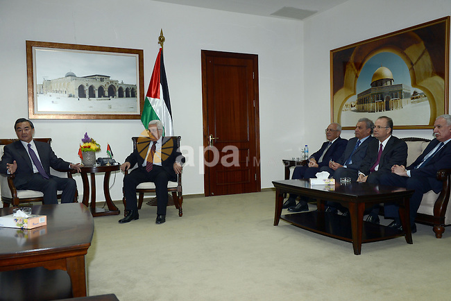 Palestinian President Mahmoud Abbas (Abu Mazen) meets with Chinese Foreign Minister in the West Bank city of Ramallah, on Dec. 18, 2013. Photo by Thaer Ganaim