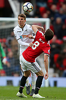 Tom Carroll of  Swansea City competes with Juan Mata of Manchester United during the Premier League match between Manchester United and Swansea City at the Old Trafford, Manchester, England, UK. Saturday 31 March 2018