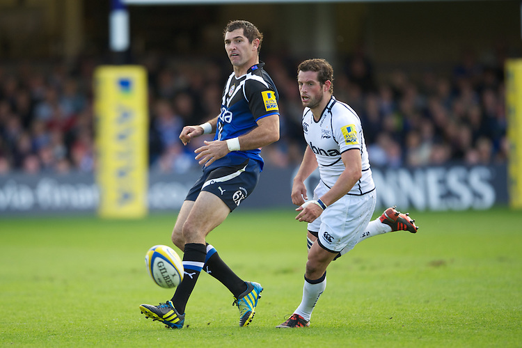 Stephen Donald of Bath Rugby chips the ball past Nick MacLeod of Sale Sharks during the Aviva Premiership match between Bath Rugby and Sale Sharks at the Recreation Ground on Saturday 29th September 2012 (Photo by Rob Munro)