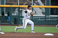 Dansby Swanson #7 of the Vanderbilt Commodores throws during Game 2 of the 2014 Men's College World Series between the Vanderbilt Commodores and Louisville Cardinals at TD Ameritrade Park on June 14, 2014 in Omaha, Nebraska. (Brace Hemmelgarn/Four Seam Images)