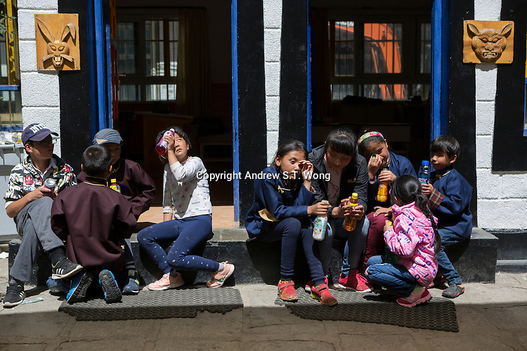 Blind and visually impaired Tibetan students sunbathe outside their classrooms at the School for the Blind in Tibet, in the capital city of Lhasa, September 2016.