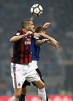 Calcio, Serie A: Milano, stadio Giuseppe Meazza, 15 ottobre 2017.<br /> Milan's Leonardo Bonucci (l) in action with Inter's Mauro Icardi (r) during the Italian Serie A football match between Inter and Milan at Giuseppe Meazza (San Siro) stadium, October15, 2017.<br /> UPDATE IMAGES PRESS/Isabella Bonotto