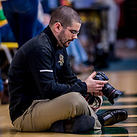26 January 2019: University of Vermont Catamount Director of Athletic Communications & Broadcasting, Nich Hall, works on the sidelines during a game against the Stony Brook Seawolves at Patrick Gymnasium in Burlington, Vermont. The Lady Seawolves defeated the Lady Catamounts 67-61 in America East Women's Basketball. Mandatory Credit: Ed Wolfstein Photo *** RAW (NEF) Image File Available ***
