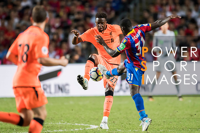 Liverpool FC forward Divock Origi (L) fights for the ball with Crystal Palace midfielder Jeffrey Schlupp (R) during the Premier League Asia Trophy match between Liverpool FC and Crystal Palace FC at Hong Kong Stadium on 19 July 2017, in Hong Kong, China. Photo by Weixiang Lim / Power Sport Images