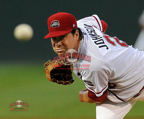 Starting pitcher Brian Johnson (28) of the Greenville Drive throws in a game against the Lexington Legends on Monday, August 19, 2013, at Fluor Field at the West End in Greenville, South Carolina. (Tom Priddy/Four Seam Images)