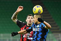 Football Soccer: Tim Cup Quarter Finals InternazionaleMIlan vs Milan, Giuseppe Meazza Stadium (San Siro) Milan, on January 26, 2021.<br /> Inter's Alexis Sanchez (r) in action with Milan's captain Alessio Romagnoli (l) during the Italian Tim Cup football match between Inter  and Milan at the Giuseppe Meazza stadium in Milan, January 26, 2021.<br /> UPDATE IMAGES PRESS/Isabella Bonotto