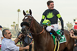 ARCADIA, CA  DECEMBER 26: #5 Bowies Hero, ridden by Kent Desormeaux, in the winners circle after winning the Mathis Brothers Mile (Grade ll) on December 26, 2017 at Santa Anita Park in Arcadia, CA.(Photo by Casey Phillips/ Eclipse Sportswire/ Getty Images)