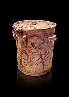 Minoan  bridge spouted lidded jar decorated with flowers, Archanes Palace  1600-1450 BC; Heraklion Archaeological  Museum, black background.