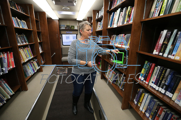 Humboldt County Bookmobile driver Ginny Dufurrena talks about the program as library representatives from across the state discuss their resources and funding concerns with lawmakers in Carson City, Nev., on Wednesday, March 6, 2019. <br /> Photo by Cathleen Allison/Nevada Momentum