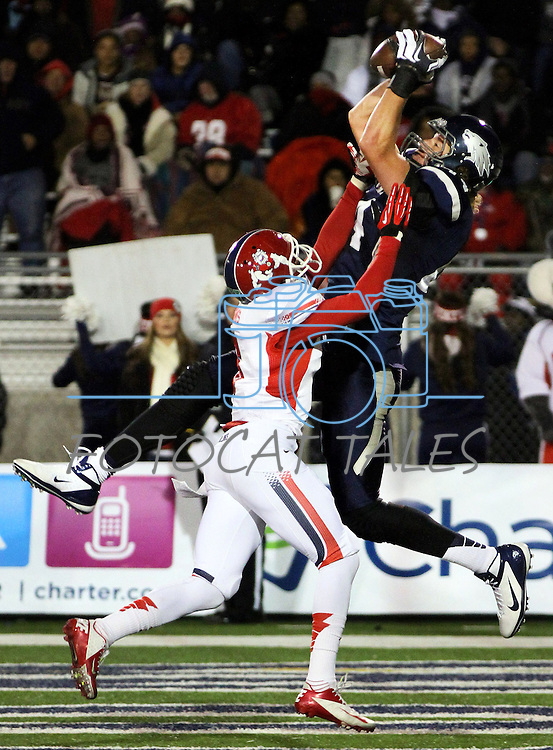 Nevada's Zach Sudfeld (44) catches the ball in the end zone against Fresno's L.J Jones (6) during the first half of an NCAA college football game in Reno, Nev., on Saturday, Nov. 10, 2012. Sudfeld dropped the ball before landing his feet and the play was ruled incomplete. (AP Photo/Cathleen Allison)