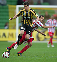 MELBOURNE, AUSTRALIA - SEPTEMBER 19, 2010: Troy Hearfield from the Phoenix is challenged by Josip Skoko from the Heart in Round 7 of the 2010 A-League between the Melbourne Heart and Wellington Phoenix at AAMI Park on September 19, 2010 in Melbourne, Australia. (Photo by Sydney Low / Asterisk Images)