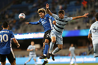 SAN JOSE, CA - MAY 22: Cade Cowell #44 of the San Jose Earthquakes goes up for a header with Kaveh Rad #48 of Sporting Kansas City during a game between Sporting Kansas City and San Jose Earthquakes at PayPal Park on May 22, 2021 in San Jose, California.