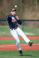 Kenny Towns (9) of the Virginia Cavaliers makes a throw to first base during infield practice prior to the game against the Hartford Hawks at The Ripken Experience on February 27, 2015 in Myrtle Beach, South Carolina.  The Cavaliers defeated the Hawks 5-1.  (Brian Westerholt/Four Seam Images)